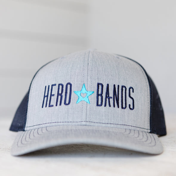 gray trucker hat embroidered with hero bands logo