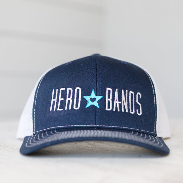 navy blue trucker hat embroidered with hero bands logo