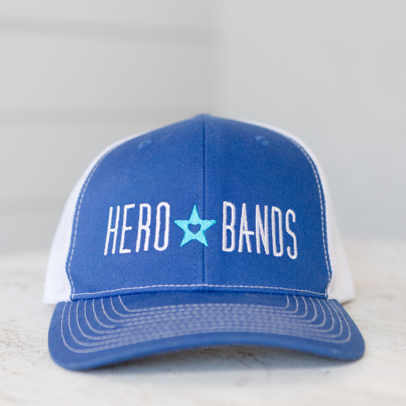 royal blue trucker hat embroidered with hero bands logo