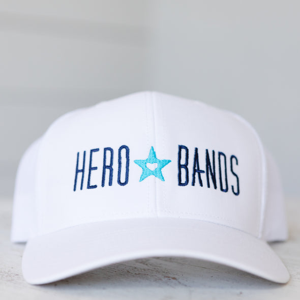 white trucker hat embroidered with hero bands logo