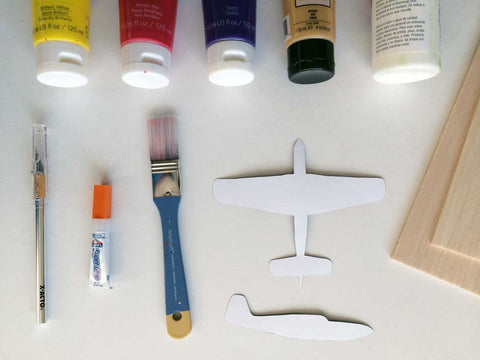 Supplies for a wooden airplane mobile