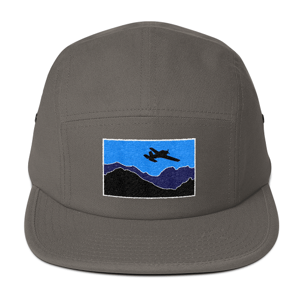 This blue airplane scene embroidered on a gray camper style hat is the perfect gift for the pilot in your life.