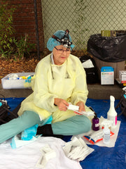 Foot nurse Laura Roehrick discussing her foot care kit at her project Street Feet in Santa Rosa, CA