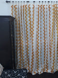 Cotton block printed French window curtains with chevrons printed in mustard