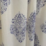 Ethnic motifs block printed in blue on a sheer decorative cotton window curtain