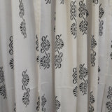 block printed motifs on a sheer white cotton decorative window curtain
