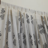 Loops tailored on a sheer cotton window curtain with ethnic motifs