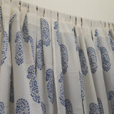 loops tailored on a decorative sheer white cotton window curtain