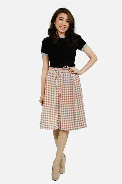 Pink gingham skirt with button accent