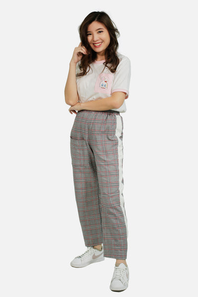 Red tartan trousers with white side strip