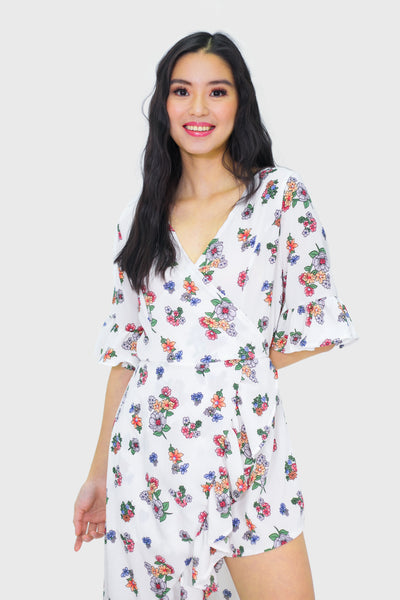 White floral romper with ruffles cape