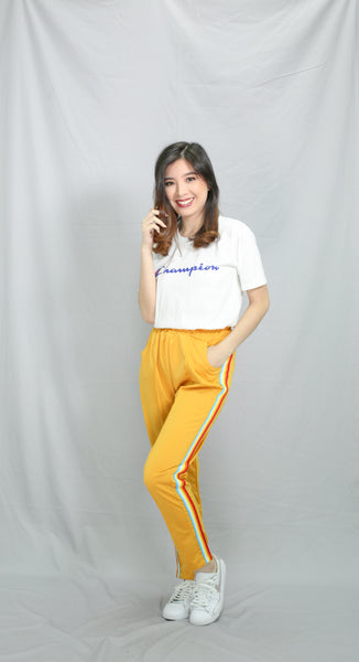 Yellow track pants with rainbow strip
