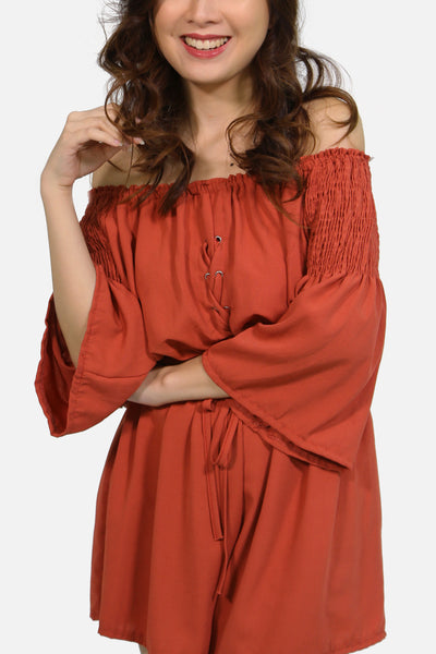 Off shoulder crisscross garterized romper