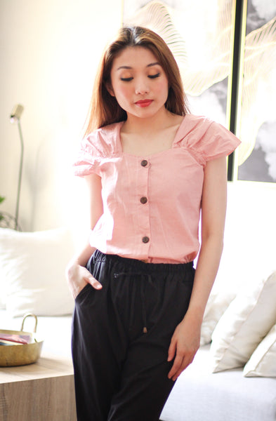 Pink sleeveless with brown button