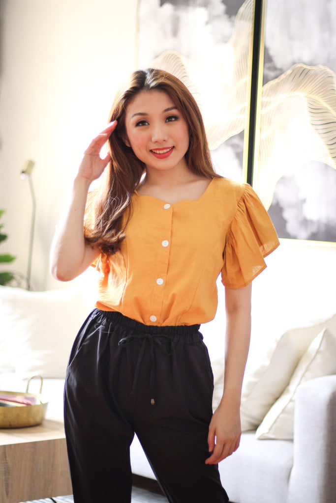 Mustard top with flowy sleeve