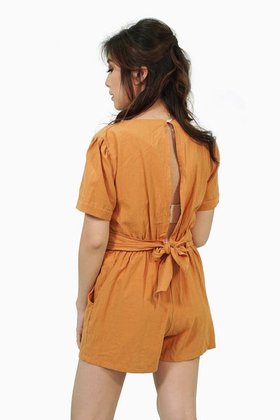 Brown romper with back cut out