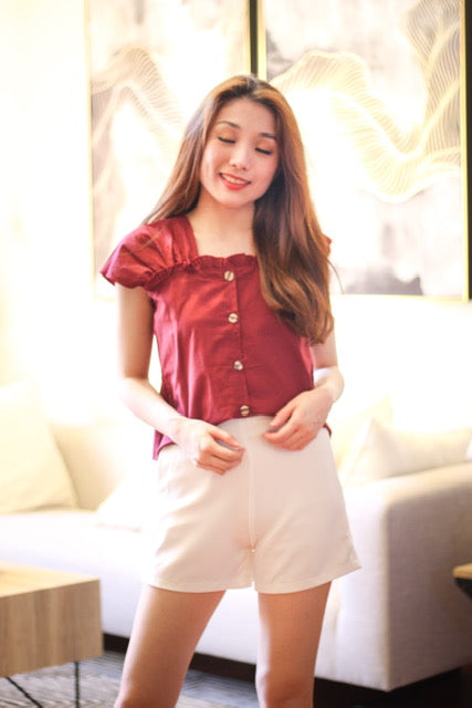Maroon sleeveless with button accent