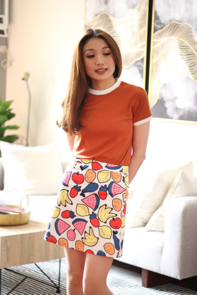 White skirt with printed fruits