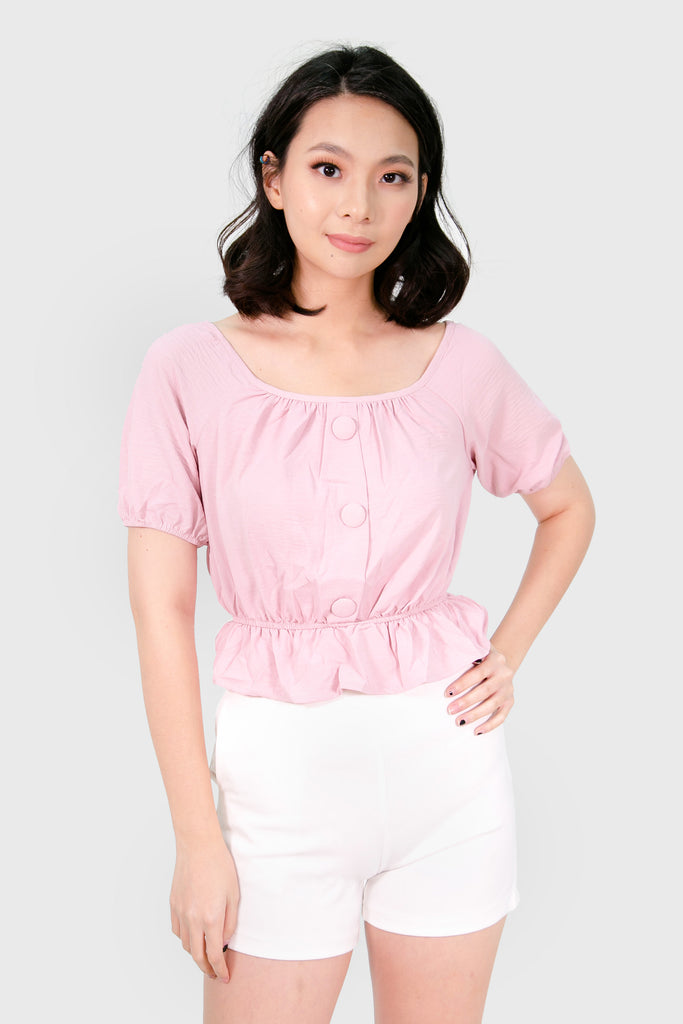Pink peplum with cloth button