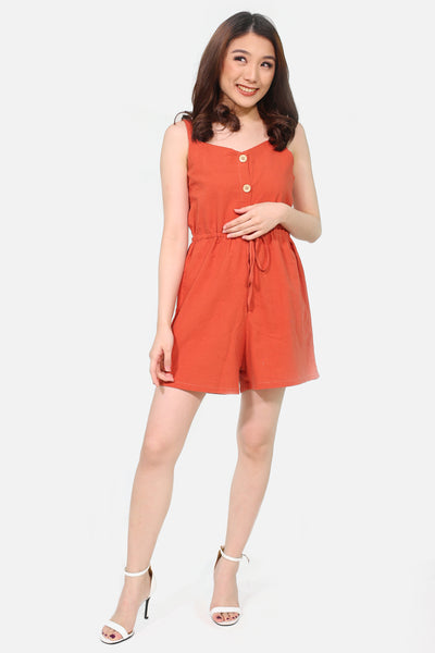 Apricot spag linen romper with button accent