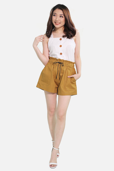 Brown shorts with big pocket and black knot
