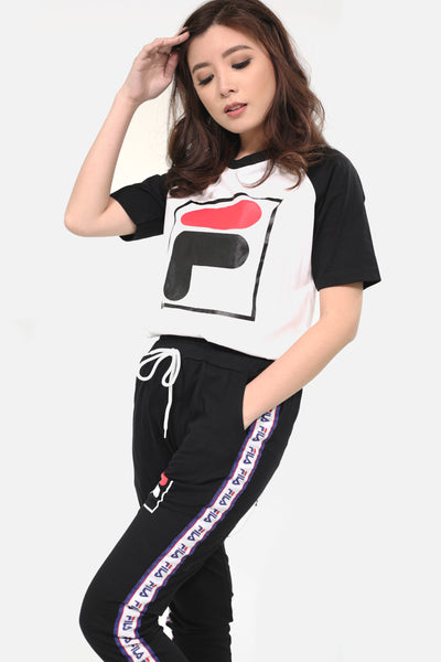 Black accent fila shirt and fila band track pants