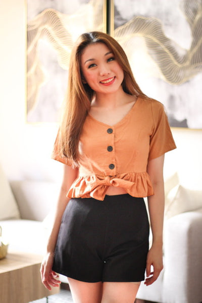 Brown ribbon top with black button