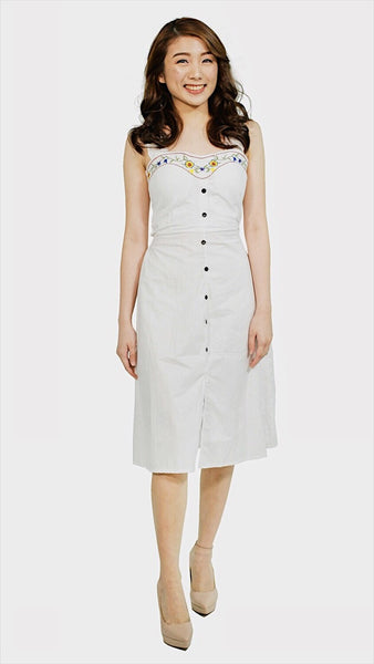 Padded dress with embroidered and ruffles strap