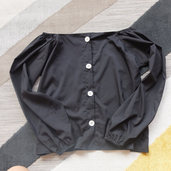 Black off shoulder button accent