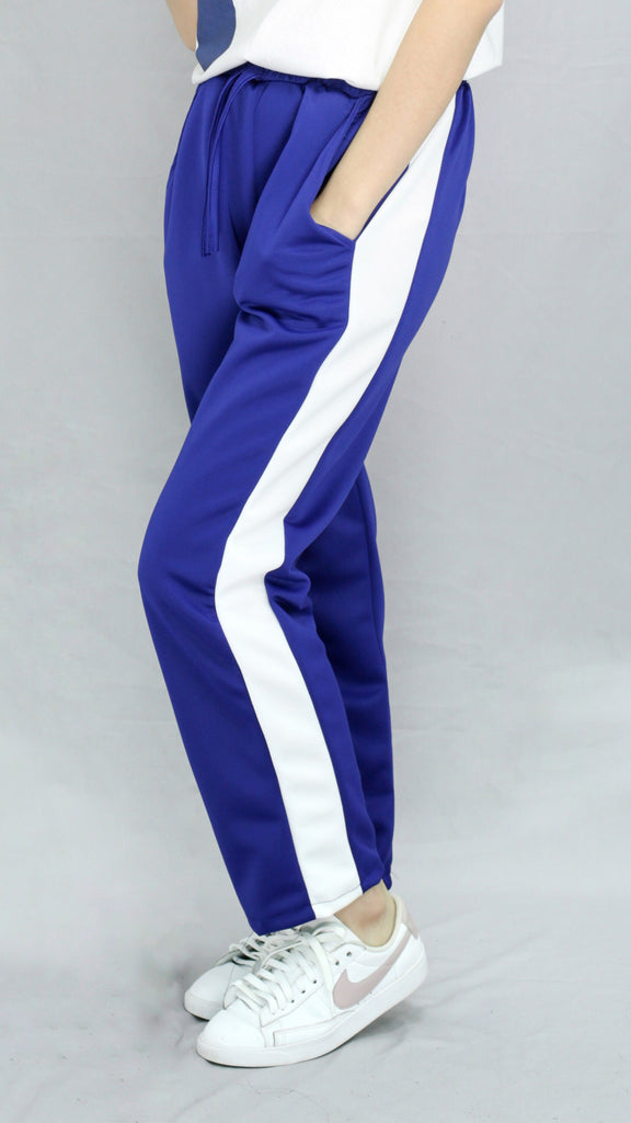 Royal blue track pants with white strip