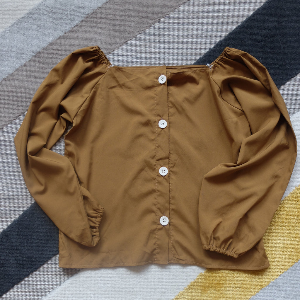 Brown off shoulder button accent