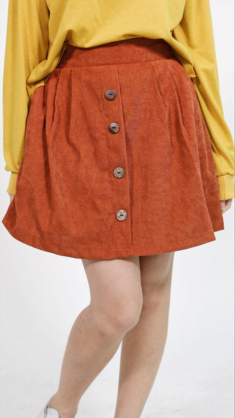 Apricot cordoroy skirt with button accent and short lining