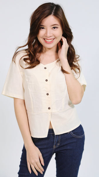 Cream sleeveless button down linen top
