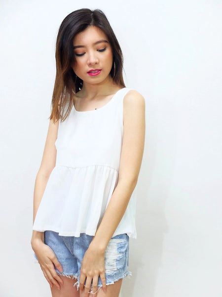 white peplim top with heart back