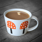 Becky Baur mushrooms mug with tea in it