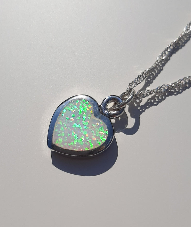 Silver white opal heart shaped pendant on silver chain