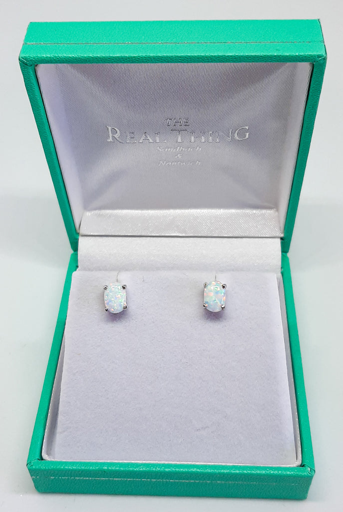 White Opal Oval Claw Set Stud Earrings