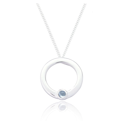 silver circle pendant with small blue topaz stone