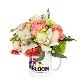 orchids, roses, hydrangeas, local seasonal flowers in a coffee mug