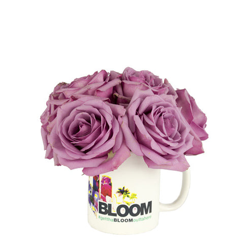 Purple roses in a mug