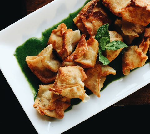 cranberry goat cheese and chive fried wonton in a platter