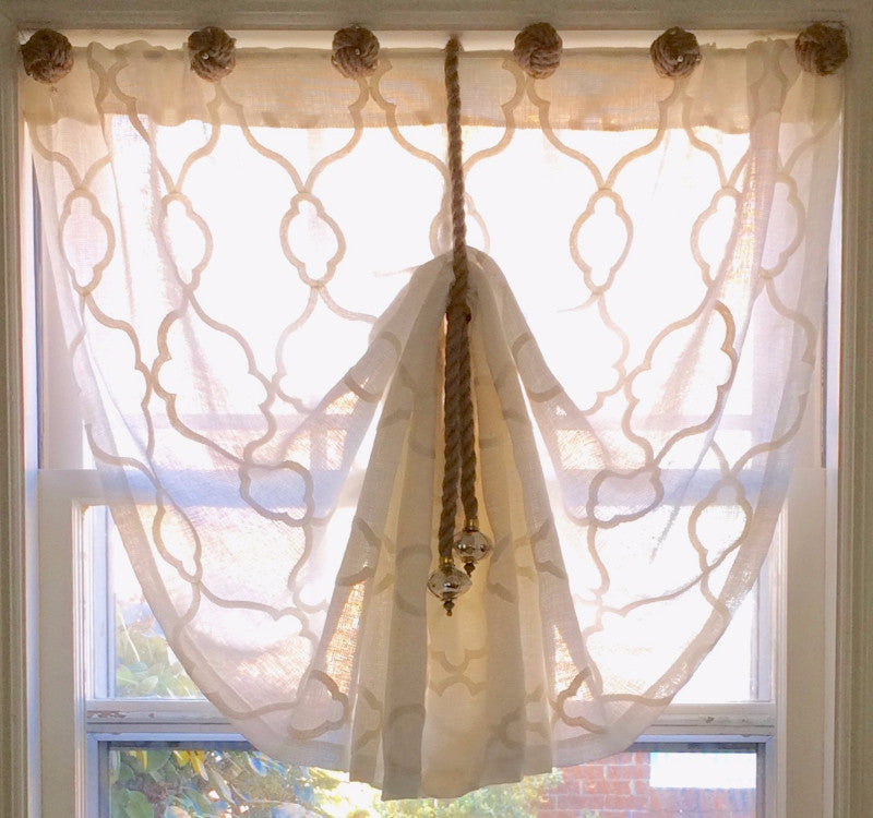 Window treatment tieback made from hemp rope and multi-faceted mercury glass accents with silver and gold detailing.