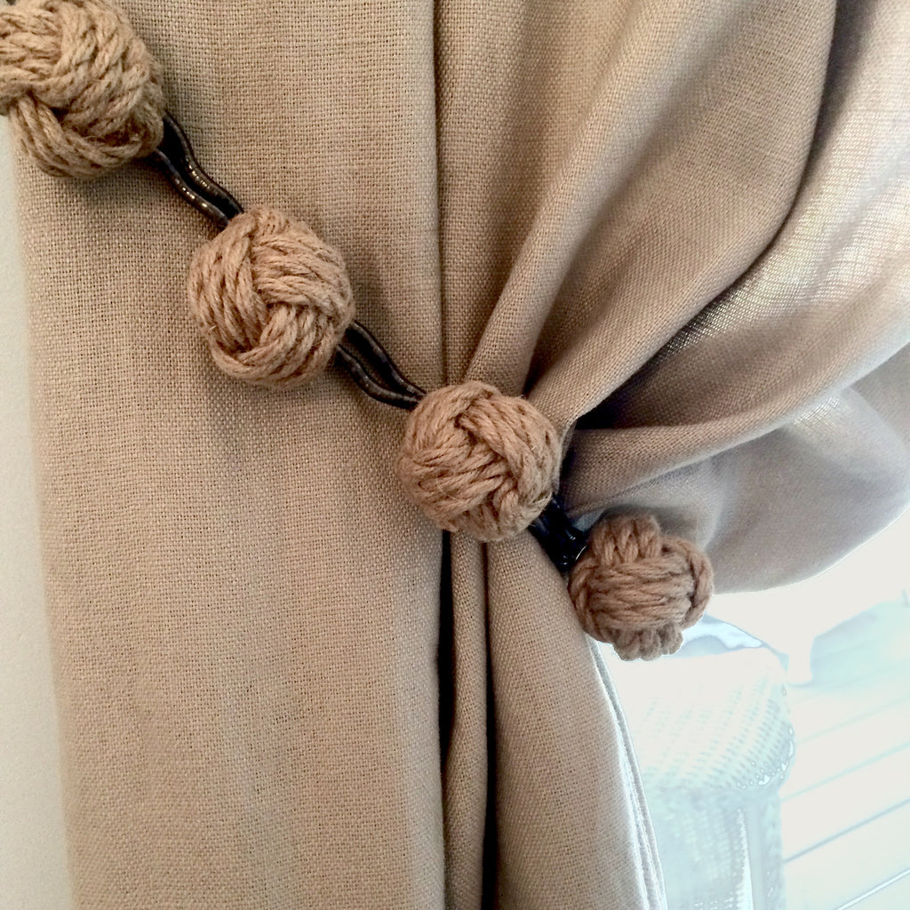 Decorative mini knots with magnetic hardware to embellish draperies, window hardware, lamps, table linens and pillows