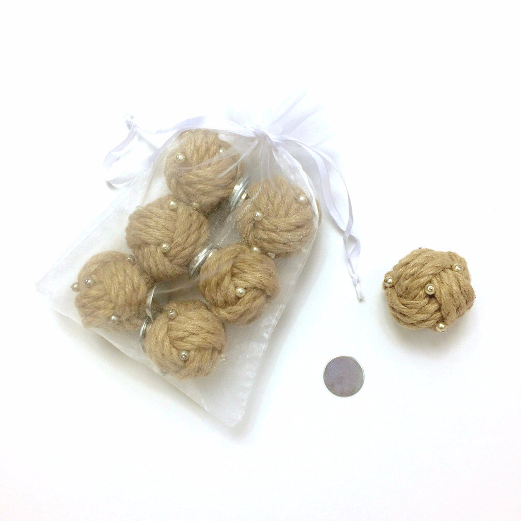 Miniature magnetic knots created from textured hemp rope embellished with pearl detailing for you to adorn draperies, window hardware, lamps, table linens and pillows
