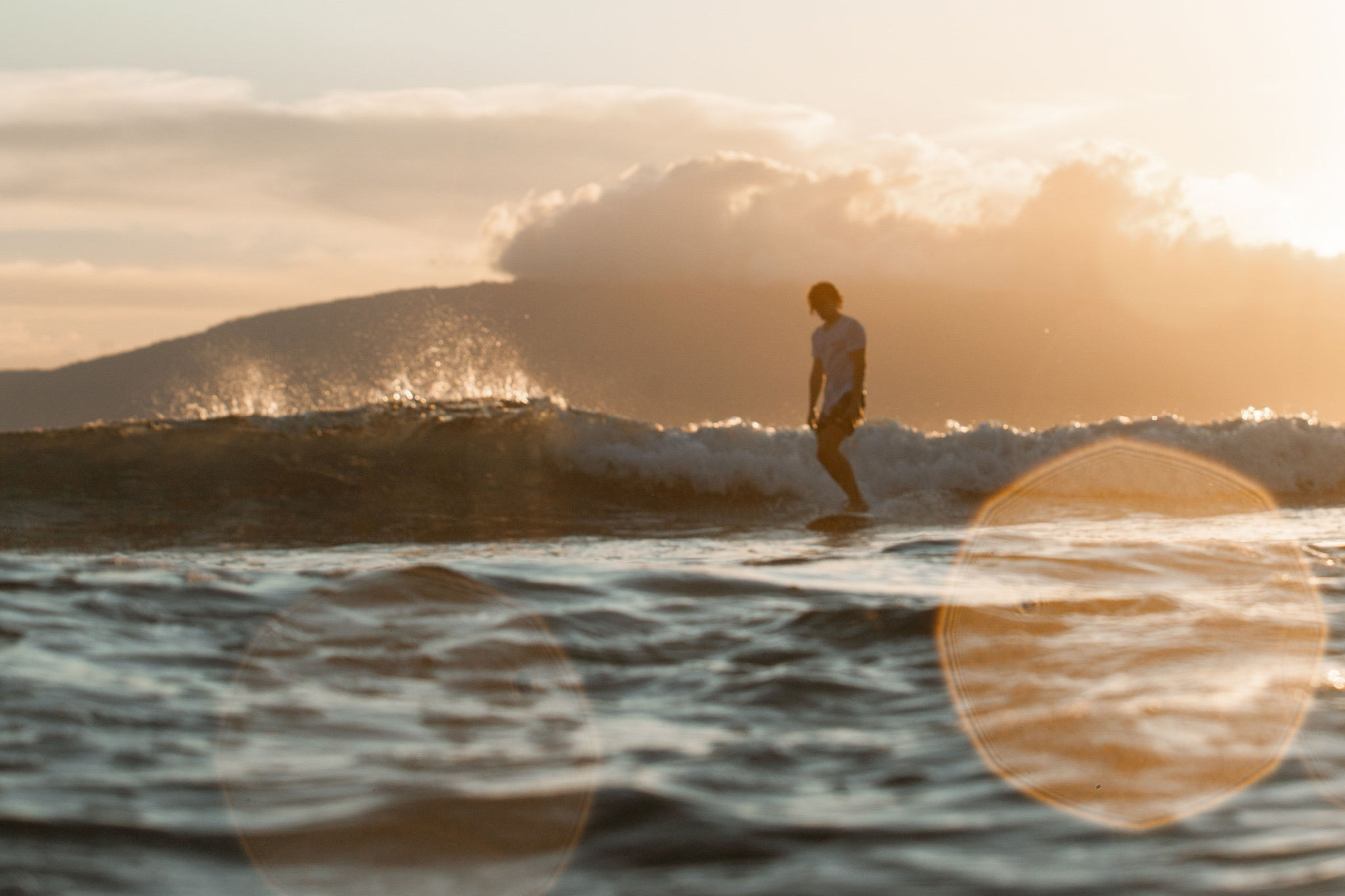 Surfing in Hawaii during sunset