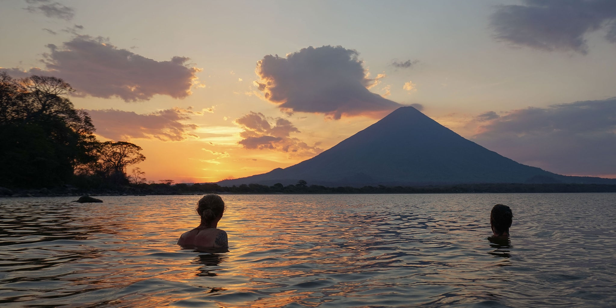 Bather - Excellent Adventures - Swimming in Nicaragua during sunset