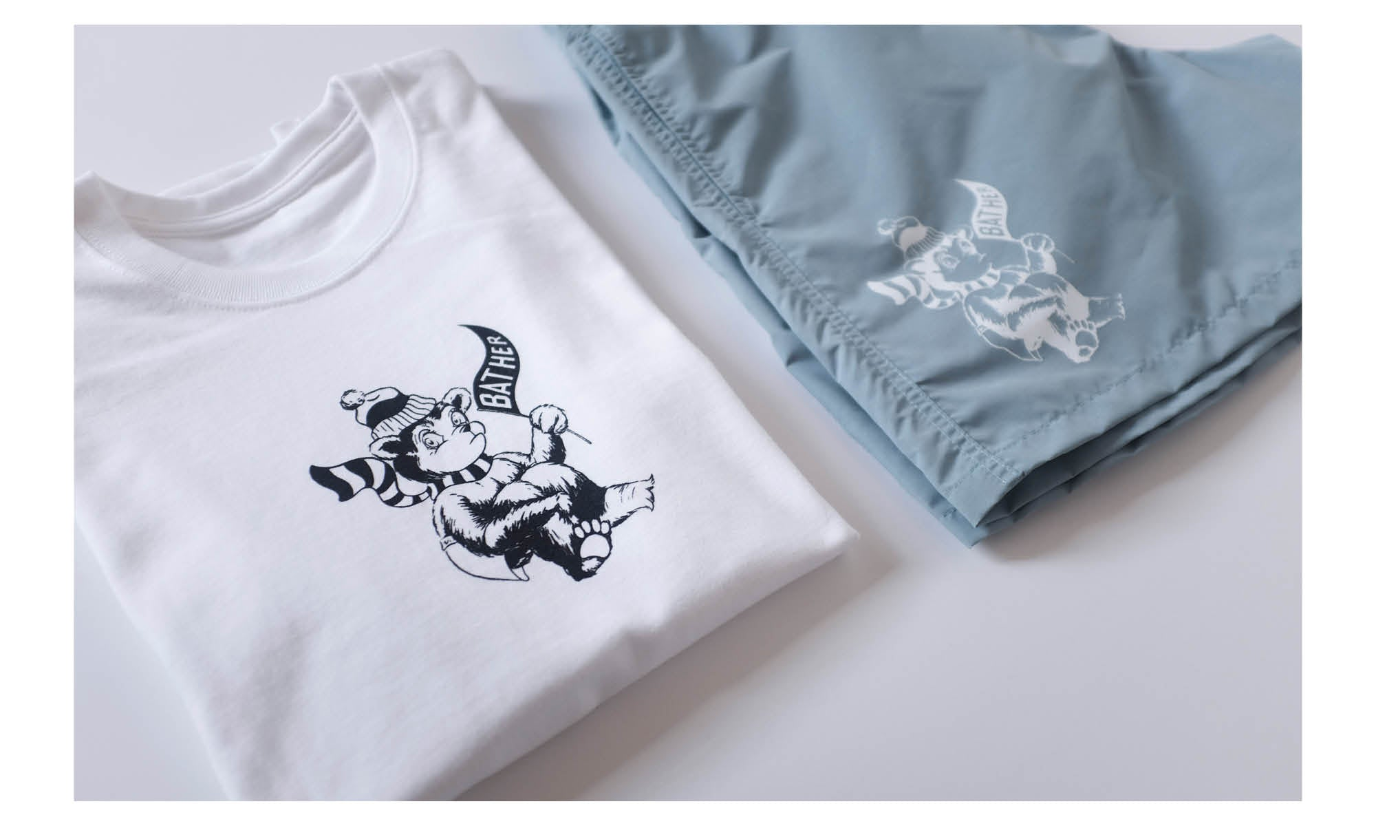 Bather t-shirt and swim trunks with swimming polar bear