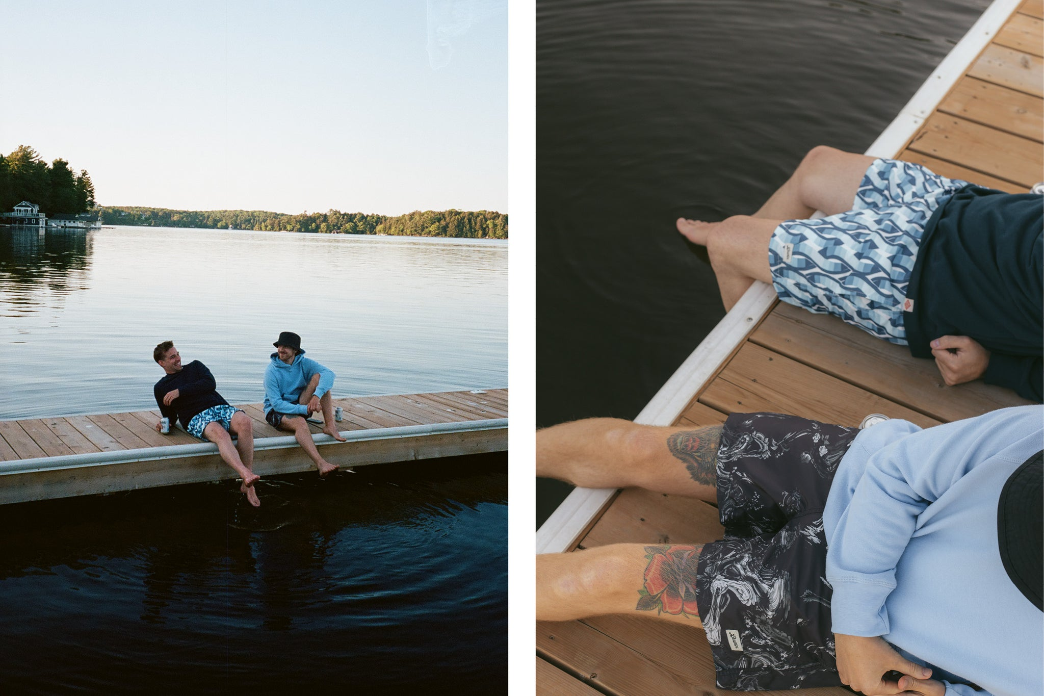 Two men sitting on a lake dock wearing hoodies and swim trunks while the sun sets