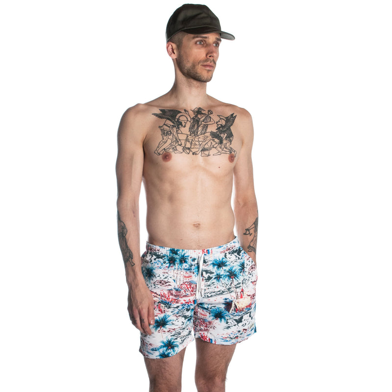 Man wearing swim trunks with Hawaiian pattern