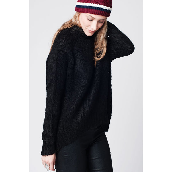 Black asymmetric wool knit sweater with ribbed turtle neck